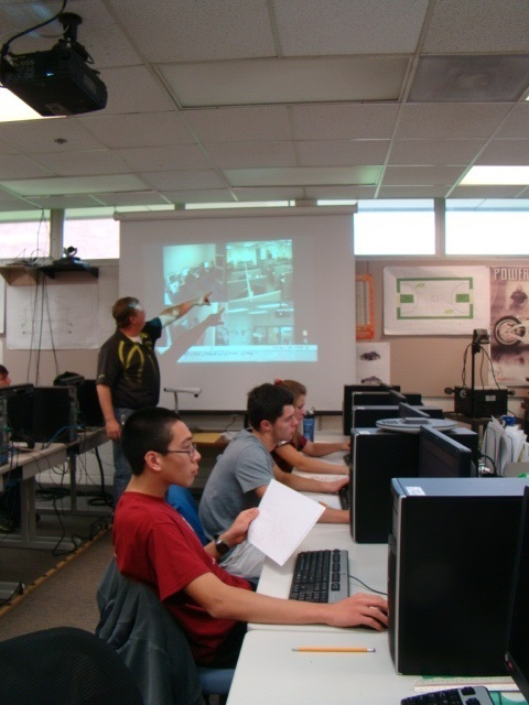 Students following instructions while working at their computers.
