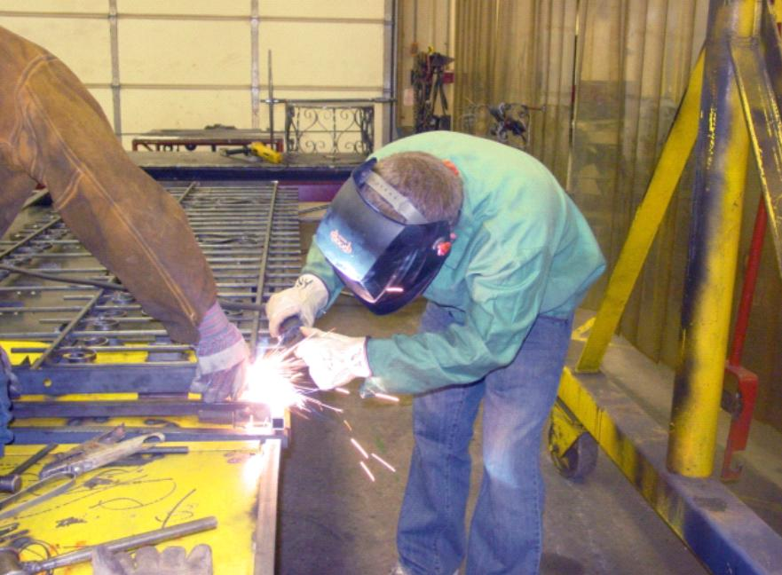 Students welding a frame