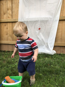 Little boy playing outside.